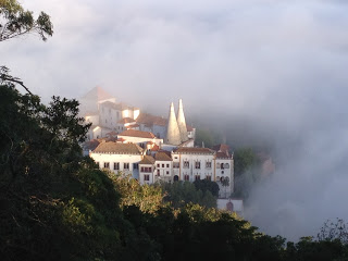 The view of the National Palace from the Moorish Castle as the morning mist arises